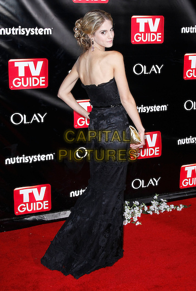 KELLY KRUGER.TV Guide Sixth Annual After Party Celebrating the 60th Annual Primetime Emmy Awards held at Kress, Los Angeles, California, USA..September 21st, 2008.full length black strapless dress hand on hip gold clutch bag looking over shoulder .CAP/ADM/MJT.© MJT/AdMedia/Capital Pictures.