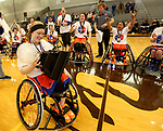 MARSHALL, MN - MARCH 17:  Morgan Wood #10 from the University of Texas Arlington holds the championship trophy as they celebrate their 65-55 win over Alabama in the championship game at the 2018 National Intercollegiate Wheelchair Basketball Tournament at Southwest Minnesota State University in Marshall, MN. (Photo by Dave Eggen/Inertia)