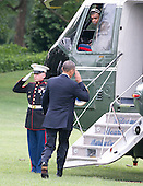 United States President Barack Obama salutes the Marine Guard as he boards Marine 1 to depart the South Lawn of the White House in Washington, D.C. for speeches in Galesburg, Illinois and Warrensburg, Missouri on Wednesday, July 24, 2013.<br /> Credit: Ron Sachs / Pool via CNP