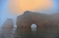 Roche Perce and Atlantic Ocean sin fog at sunrise on Gaspe Peninsula<br /> , Perce, Quebec, Canada