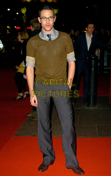 "WILL YOUNG.UK Premiere of ""300"" at Vue West End, Leicester Square, London, UK..full length grey gray trousers brown jumper sweater glasses hand in pocket green  .CAP/CAN.©Can Nguyen/Capital Pictures"