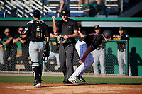 Umpire Mitch Trzeciak calls Nic Ready (51) out after a tag by catcher Kyle Wilkie (10) during a NY-Penn League game between the West Virginia Black Bears and Batavia Muckdogs on June 27, 2019 at Dwyer Stadium in Batavia, New York.  West Virginia defeated Batavia 6-5 in ten innings.  (Mike Janes/Four Seam Images)