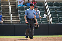 Home plate umpire Reed Basner works the South Atlantic League game between the Hagerstown Suns and the Kannapolis Intimidators at Kannapolis Intimidators Stadium on July 9, 2017 in Kannapolis, North Carolina.  The Intimidators defeated the Suns 3-2 in game one of a double-header.  (Brian Westerholt/Four Seam Images)