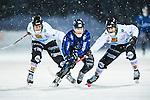 Uppsala 2014-01-12 Bandy  IK Sirius - GAIS Bandy :  <br />  Sirius Ilja Grachev i kamp om bollen med GAIS Calle Johansson och GAIS Joel Pettersson <br /> (Foto: Kenta J&ouml;nsson) Nyckelord: