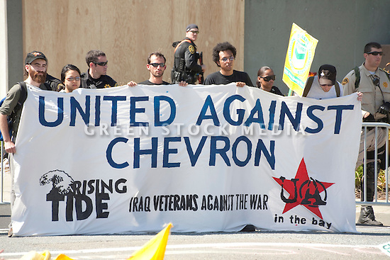 August 15, 2009. About two hundred people participated in a rally, march, and demonstration protesting Chevron's Richmond oil refinery renovation and expansion project. The event was organized by Mobilization for Climate Justice-West, a coalition of over thirty organizations, working to bring awareness to the refinery issue as well as the United Nations Climate Change Conference taking place in December in Copenhagen. Event organizers claim that the Richmond refinery project will allow the facility to refine heavier and dirtier crude that will result in more air pollution, greenhouse gas (GHGs) emissions, and health risks. A court ruling recently put the refinery project on hold saying that further environmental impact reporting was needed. Many protesters were also concerned about the environmental and human health impacts of oil company projects outside the United States. Richmond, California, USA