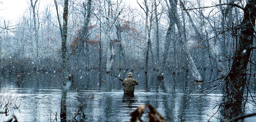 Green timber duck hunter in snow storm, Poor Boy Club, Humnoke, Arkansas