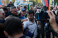 """Matteo Salvini (Leader of the Lega/League, former Deputy Prime Minister & Minister of the Interior of Italy).<br /> <br /> Rome, 19/10/2019. Today, tens thousands of people (200,000 for the organisers, 50,000 for the police) gathered in Piazza San Giovanni to attend the national demonstration """"Orgoglio Italiano"""" (Italian Pride) of the far-right party Lega (League) of Matteo Salvini. The demonstration was supported by Silvio Berlusconi's party Forza Italia and Giorgia Meloni's party Fratelli d'Italia (Brothers of Italy, right-wing).  <br /> The aim of the rally was to protest against the Italian coalition Government (AKA Governo Conte II, Conte's Second Government, Governo Giallo-Rosso, 1.) lead by Professor Giuseppe Conte. The 66th Government of Italy is a coalition between Five Star Movement (M5S, 2.), Democratic Party (PD – Center Left, 3.), and Liberi e Uguali (LeU – Left, 4.), these last two parties replaced Lega / League as new members of a coalition based on Parliamentarian majority as stated in the Italian Constitution. The Governo Conte I (Conte's First Government, 5.) was 14-month-old when, between 8 and 9 of August 2019, collapsed after the Interior Minister Matteo Salvini withdrew his euroskeptic, anti-migrant, right-wing Lega / League (6.) from the populist coalition in a pindaric attempt (miserably failed) to trigger a snap election.<br /> <br /> Footnotes & Links:<br /> 1. http://bit.do/feK6N<br /> 2. http://bit.do/e7JLx<br /> 3. http://bit.do/e7JKy<br /> 4. http://bit.do/e7JMP<br /> 5. http://bit.do/e7JH7<br /> 6. http://bit.do/eE7Ey<br /> https://www.leganord.org<br /> http://bit.do/feK9X (Source, TheGuardian.com)<br /> Reportage: """"La Fabbrica Della Paura"""" (The Factory of Fear): http://bit.do/feLcy (Source Report, Rai.it - ITA)<br /> (Update) Reportage: """"La Fabbrica Social Della Paura"""" (The Social Network Factory of Fear): http://bit.do/fe8Pn (Source Report, Rai.it - ITA)"""