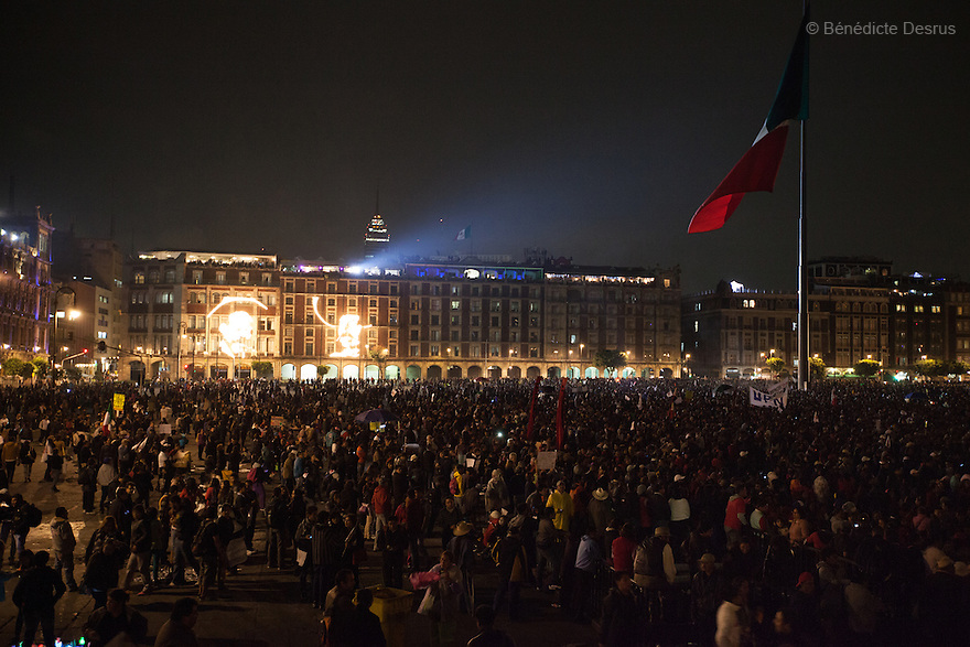 Tens of thousand of protesters gather on Zocalo, the city's main square, during a massive march in support of the 43 missing Ayotzinapa's students, on a day normally reserved for the celebration of Mexico's 1910-17 Revolution, in Mexico City, Mexico on November 20, 2014. Parents of the 43 missing students still do not believe the official line that the young men are all dead. Criticism of the government has intensified in Mexico and the country has been convulsed by protests. Many are demanding justice and that the search for the 43 missing students continue until there is concrete evidence to the contrary. Mexico officially lists more than 20 thousand people as having gone missing since the start of the country's drug war in 2006, and the search for the missing students has turned up other, unrelated mass graves. (Photo by Bénédicte Desrus)
