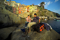 Riomaggiore, Cinque Terre, Liguria, Italy, May 2005. Built against the steep cliffs of the Ligurian coast of Italy, lie the five villages of the Cinque Terre. Ancient hiking trails connecting the villages offer some of Italy's most spectacular views. Photo by Frits Meyst/Adventure4ever.com