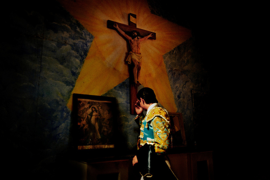 Before his bullfight matador Omar Villasenor prays for good health in the church within Plaza Monumental, Tijuana, Baja de California, Mexico, August 12, 2007. The last time Villasenor fought at this arena he was gored twice by a bull..