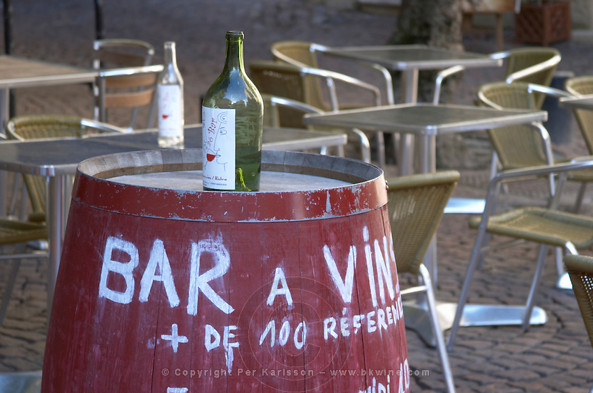 A wine bar. Barrel with bottle advertising. Place Saint Pierre. Bordeaux city, Aquitaine, Gironde, France