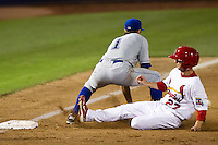 Shane Robinson (27) of the Springfield Cardinals slides safely into third base during a game against the Tulsa Drillers at Hammons Field on July 19, 2011 in Springfield, Missouri. Tulsa defeated Springfield 17-11. (David Welker / Four Seam Images)