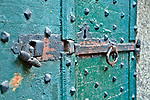 Old lock on a green door in the Lake Como town of Gravedona, Italy