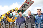 PLANNING: Tony Walsh (left) who has again been refused planning for the construction of a retail unit in Castleisland, looks on with Cllr Brendan Cronin and Maurice Walsh of Walsh Steel as the company sign is taken down on Friday.