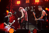 SUNRISE FL - DECEMBER 18: Calum Hood, Luke Hemmings, Michael Clifford of 5 Seconds Of Summer perform at the Y100 Jingle Ball 2015 held at The BB&T Center on December 18, 2015 in Sunrise, Florida. (Photo by Larry Marano © 2015
