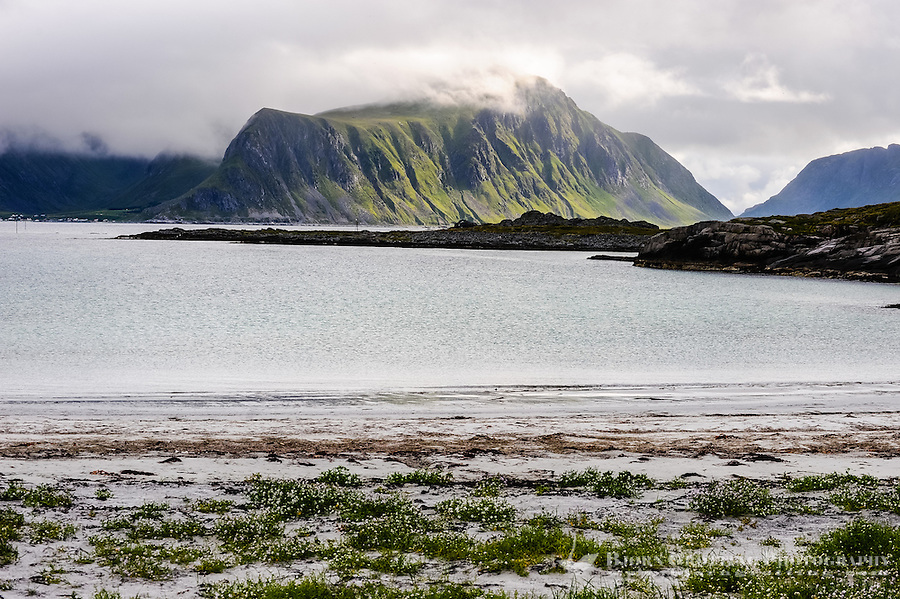 Norway, Lofoten. Close to Fredvang on the northern part of Moskenesøya. Mountains on the far side of the sea.