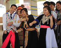 NWA Democrat-Gazette/ANDY SHUPE<br /> Jesse Tran (from left), Dana Ninkham and Emily Yang, all members of the Hmong Student Organization of Arkansas at the University of Arkansas, dance the whip/nae nae Saturday, Sept. 19, 2015,  during the Welcoming NWA: Celebrating the Cultural Diversity of Northwest Arkansas event at Shiloh Square in downtown Springdale. The event was organized by Engage NWA, a coalition of nonprofit organizations, businesses and community members, to celebrate National Welcoming Week.