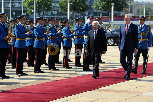 Palestinian President Mahmoud Abbas is accompanied by Serbian President Tomislav Nikolic as they inspect a guard og honor during Abbas' arrival in Belgrade, Serbia, 10 June 2015. Abbas is on an one day official visit to Serbia. Photo by Thaer Ganaim