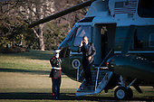 United States President Barack Obama salutes the Marine Guard as he heads to the White House from Marine One after landing on the South Lawn of the White House in Washington, District of Columbia, U.S., on Wednesday, March 18, 2015. The President was returning from a trip to Cleveland where he took part in a tour at MAGNET (Manufacturing Advocacy and Growth Network) and deliver remarks on the importance of middle class economics to the City Club of Cleveland. <br /> Credit: Pete Marovich / Pool via CNP