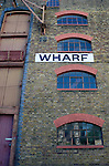 Wharf sign on former warehouses now used as apartments, Wapping, London