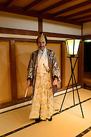 Trying on a Daimyo kimono at Okayama castle. Okayama, Okayama Prefecture, Japan, October 7, 2015. The southern city of Okayama is well-known for its temperate climate, castle, and the beautiful traditional Korakuen gardens.