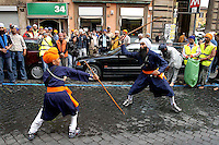 """Rome April 30 2006  .Piazza Vittorio  .Sikh """"Punj Pyare"""" (Five Beloved Ones) lead a religious parade.The parade is for Visaki, a traditional Sikh celebration..The traditional Sikh martial art"""