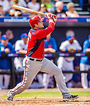 23 February 2013: Washington Nationals catcher Chris Snyder hits a two-run homer in the second inning in his first plate appearance as a National during Spring Training action against the New York Mets at Tradition Field in Port St. Lucie, Florida. The Mets defeated the Nationals 5-3 in their Grapefruit League Opening Day game. Mandatory Credit: Ed Wolfstein Photo *** RAW (NEF) Image File Available ***