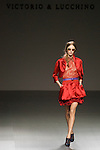 MADRID, SPAIN - FEBRUARY 04: A model walks the runway in the Victorio and Lucchino fashion show during the Mercedes-Benz Fashion Week Madrid Autumn/Winter 2012 at Ifema on February 4, 2012 in Madrid, Spain. (Photo by Juan Naharro Gimenez)