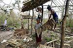 Cyclone Nargis survivors rebuild there home, in Irrawaddy Division, May 10, 2008. Despairing survivors in Myanmar awaited emergency relief on Friday, a week after 100,000 people were feared killed as the cyclone roared across the farms and villages of the low-lying Irrawaddy delta region. The storm is the most devastating one to hit Asia since 1991, when 143,000 people were killed in neighboring Bangladesh. Photo by Eyal Warshavsky  *** Local Caption *** ëì äæëåéåú ùîåøåú ìàéì åøùáñ÷é àéï ìòùåú áúîåðåú ùéîåù ììà àéùåø
