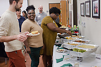 Left to right: Nick Antonicci, director of the Center for Sexual and Gender Diversity at Duke, and Office Coordinator Brittney Brown at a WorkOUT Potluck at the Center for Sexual and Gender Diversity at Duke University in Durham, North Carolina Monday, November 12, 2018. (Justin Cook)