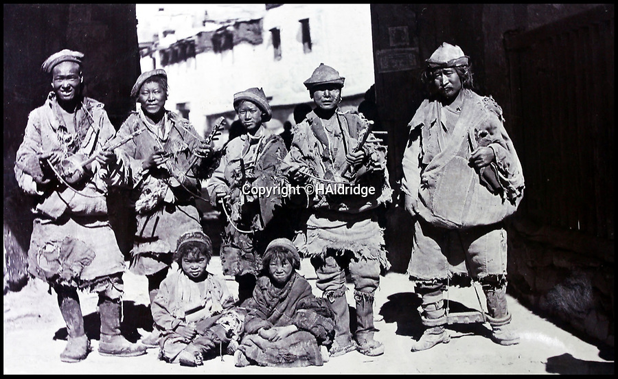 BNPS.co.uk (01202 558833)Pic: HAldridge/BNPS<br /> <br /> Tibetan minstrels in Gyangste.<br /> <br /> Game tales from the hills...remarkable album shows British attempts to win over newly invaded Tibet by playing sport's straight from the playing fields of England.<br /> <br /> A collection of photos have come to light which show the people of the remote Himalayan nation of Tibet embracing one of the traditional British pastimes - a sports day.<br /> <br /> The archive of more than 500 photos was collated by a British Lieutenant Colonel, R C MacGregor, of the Indian Medical Service, who was present in Tibet between 1904 and 1912.<br /> <br /> These photos are one of the earliest examples of the British attempting to win 'the hearts and minds' of a native population as they were taken during the controversial Younghusband expedition to the distant Buddhist country.<br /> <br /> The archive also features four never before seen photos of the Dalai Lama returning to Tibet in 1912 after his exile ended.