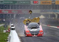 May 1, 2016; Baytown, TX, USA; Paint chips fly off the wall as NHRA funny car driver Cruz Pedregon opens his parachute during the Spring Nationals at Royal Purple Raceway. Mandatory Credit: Mark J. Rebilas-USA TODAY Sports