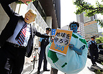 June 2, 2017, Tokyo, Japan - Members of environmental groups Greenpeace and 350.org protest against U.S. President Donald Trump's decision to pull out from the Paris climate accord near the U.S. embassy in Tokyo on Friday, June 2, 2017. Trump announced the U.S. will withdraw from the Paris climate accord to protect America and its citizens on June 1.    (Photo by Yoshio Tsunoda/AFLO) LwX -ytd-