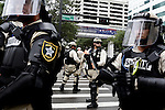 Police officers block off roads from protestors during the 2012 Republican National Convention in Tampa, Fla. on Aug. 27, 2012.