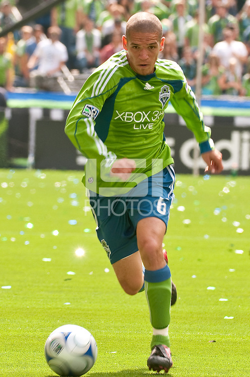 Osvaldo Alonso of the Seattle Sounders drives up the field against Toronto FC in the match at the XBox Pitch at Quest Field on August 29, 2009. The Sounders and Toronto played to a 0-0 draw.