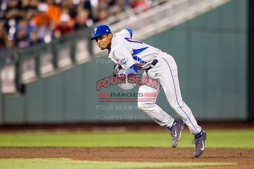 Florida Gators shortstop Richie Martin (12) prepares to make a throw to first base during the NCAA College baseball World Series against the Virginia Cavaliers on June 15, 2015 at TD Ameritrade Park in Omaha, Nebraska. Virginia defeated Florida 1-0. (Andrew Woolley/Four Seam Images)