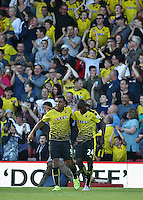 Odion Ighalo of Watford celebrates scoring the opening goal with team-mate Troy Deeney of Watford   during the Barclays Premier League match Watford and Swansea   played at Vicarage Road Stadium , Watford