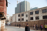 Government plans unveiled in 2009 would demolish as much as 85% of the Old City section of Kashgar, Xinjiang, China, home of the Uighurs.  The twsiting alleyways and residences would be replaced with highrise apartment buildings.