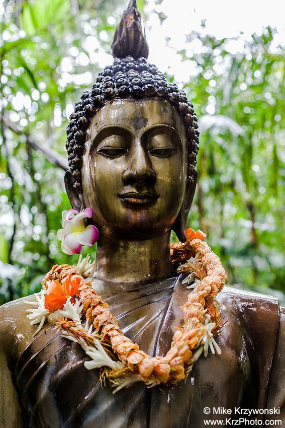 Buddha statue w/ leis at Harold L. Lyon Arboretum and Botanical Garden,Honolulu, Oahu, Hawaii
