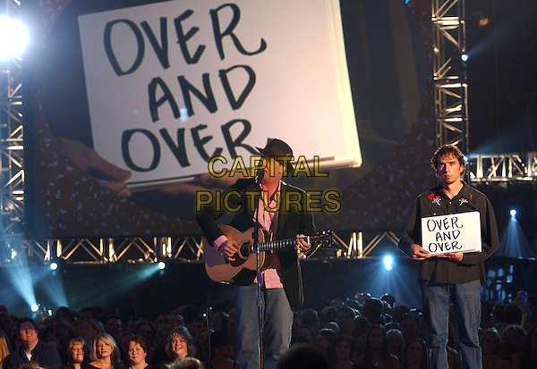 "JEFF DANIELS & BRET CALVERT.performing ""Nominee Medley"".2005 CMT Music Awards held at the Gaylord Entertainment Center, Nashville, Tennessee, USA, .11 April 2005..half length on stage sign writing over and over.Ref: ADM.www.capitalpictures.com.sales@capitalpictures.com.©Laura Farr/AdMedia/Capital Pictures."