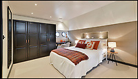 BNPS.co.uk (01202 558833)<br /> Pic:  Riverhomes/BNPS<br /> <br /> Guest bedroom...<br /> <br /> Float your boat? - stunning floating home in the heart of Chelsea comes to market.<br /> <br /> A stunning houseboat moored on the Thames at Chelsea embankment has gone on the market for &pound;1.75m.<br /> <br /> The two bedroom luxury floating home, called Walter Greaves, has all the trappings of a penthouse apartment.<br /> <br /> It was designed, built and finished by the Chelsea Yacht and Boat Company and features a contemporary open-plan design.<br /> <br /> A similar sized two-bed flat overlooking the Chelsea Embankment costs about &pound;3m, making the houseboat a relative bargain.
