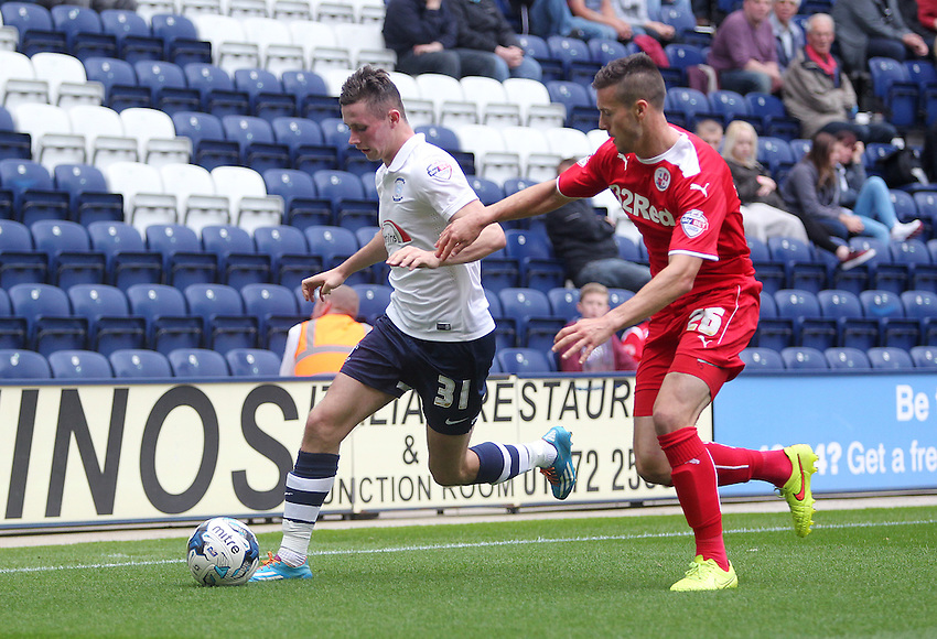 Preston North End's Alan Browne under pressure from Crawley Town's Matthew Sadler<br /> Photographer Rich Linley/CameraSport<br /> <br /> Football - The Football League Sky Bet League One - Preston North End v Crawley Town - Saturday 20th September 2014 - Deepdale - Preston<br /> <br /> &copy; CameraSport - 43 Linden Ave. Countesthorpe. Leicester. England. LE8 5PG - Tel: +44 (0) 116 277 4147 - admin@camerasport.com - www.camerasport.com
