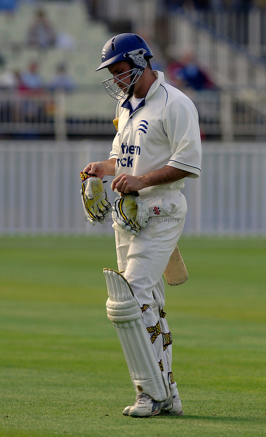 Photo. Glyn Thomas. .Warwickshire v Middlesex. 29/04/2005..Frizzell County Championship Division 1. Day 3..Middlesex's Andrew Strauss leaves the field in dejection.