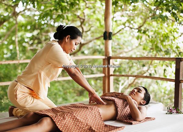 Woman Receiving Chi Nei Tsang, Taoist Abdominal Massage at Kamalaya, Koh Samui, Thailand. A woman receives a Taoist abdominal massage to improve digestion, cleanse internal organs and induce a deep, relaxed state.