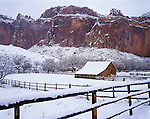 Capitol Reef National Park, UT<br /> Fresh snowfall covers the fence line, orchard and barn of the Gifford homestead under the cliffs of  Capitol Reef