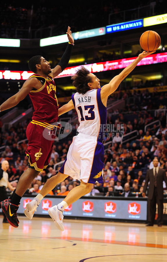 Jan. 12, 2012; Phoenix, AZ, USA; Phoenix Suns guard (13) Steve Nash drives to the basket against Cleveland Cavaliers guard (2) Kyrie Irving in the second half at the US Airways Center. The Cavaliers defeated the Suns 101-90. Mandatory Credit: Mark J. Rebilas-