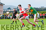 Daingean Uí Chúis Tomas Ó Súilleabhain in an action closely watched by South Kerry Brendan O'Sullivan during the match at Pairc an Aghasaigh, Dingle, on Sunday afternoon.