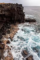Waves crash against the cliffs along South Point, Big Island.