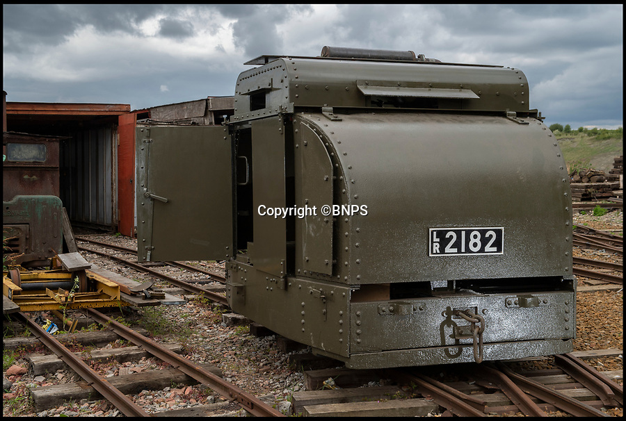BNPS.co.uk (01202 558833)<br /> Pic: PhilYeomans/BNPS.<br /> <br /> Old War Horse...back on track.<br /> <br /> The last surviving armoured locomotive used to pull munitions to the front line in World War One has been painstakingly restored a century later.<br /> <br /> Volunteers at the Greensand Trust based in Leighton Buzzard have spent the past decade bringing the historic Simplex 40HP engine back to full working order as part of a £20,000 project.<br /> <br /> The 8ft high, 10ft long loco, resembling a tank, was built in Bedford in 1917 and encased in full armour plating to protect it's plucky driver from enemy shell fire on the Western Front.<br /> <br /> It's petrol engine made it more discreet to use at night close to the front line than larger, noisier and more visible steam trains, which were easier targets for the German guns.<br /> <br /> In a world before health and safety the brave driver sat on the noisy engine, with the petrol tank and a radiator next to him in a fume filled cabin - but despite these privations he was infinitely safer inside than out.