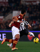 Calcio, quarti di finale di Coppa Italia: Roma vs Juventus. Roma, stadio Olimpico, 21 gennaio 2014.<br /> AS Roma defender Mehdi Benatia, of Morocco, and Juventus forward Sebastian Giovinco, right, fight for the ball during the Italian Cup round of eight final football match between AS Roma and Juventus, at Rome's Olympic stadium, 21 January 2014.<br /> UPDATE IMAGES PRESS/Isabella Bonotto